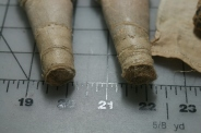 "The bottoms of the legs that were hidden underneath the sewn on ""stockings""."