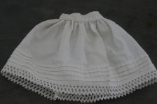 Petticoat with tucks and muktiple rows of waved braid.