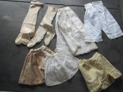 Antique petticoats, pantalettes, and stockings for the dolls.