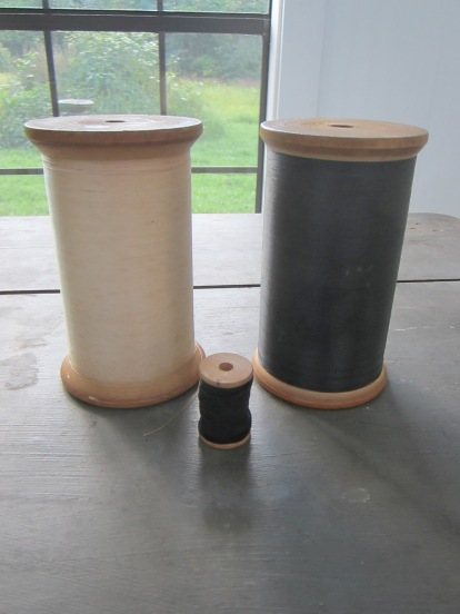 BIGGEST spools of thread in the world :) OK, probably not, but still huge. The smaller spool is normal size.