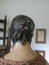 She has the most wonderfully detailed hairstyle.