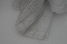 Tucks and wide broderie anglaise, on a large enough scale that one or the other would have to be chosen as the decorative element on the skirt of a dress