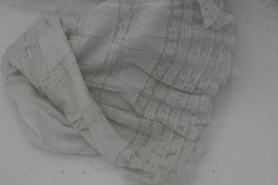 Sheer white cotton with multiple rows of lace insertion.
