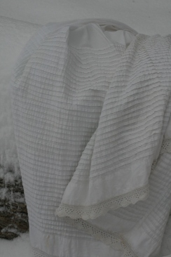 Rows upon rows of tucks with an eyelet hemline.