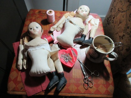 Sewing on arms, legs and second skins, in Valentine colors of red and pink <3