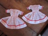 Sheer white antique cotton dresses with summery red blooms and antique red French cotton tape.