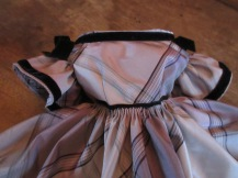 Silk paid taffeta, with a cartridge pleated skirt and lots of black velvet trim <3