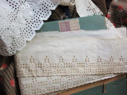 "The 19th century petticoat ruffle and a bolt of unused ""store stock"" which a almost a match!"
