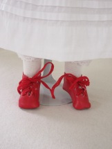 Tiny red leather shoes.