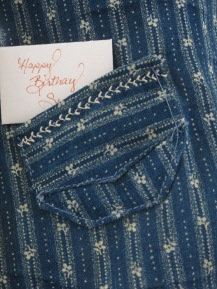 The pocket is set at an angle, which is highlighted by the print of the fabric.