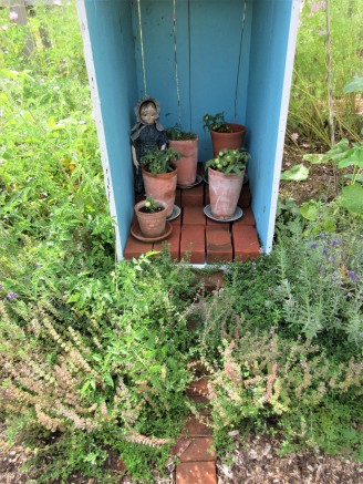 Izzybelle's sisters are all strongly suggesting that she confines her tomato gardening to pots in the greenhouse next year...